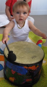 Yuliya, 1 year of age playing the drum in class