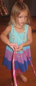 Yuliya, 2 years of age exploring hoops in class